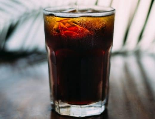 A chilled glass of organic Freetrade Karma Cola softdrink