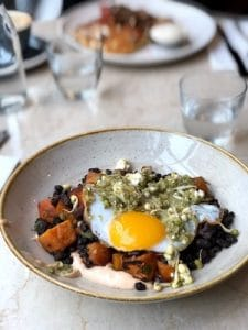 A very tasty black bean and sweet potato hash with fried duck egg and Mexican flavours at Caravan Fitzrovia, London